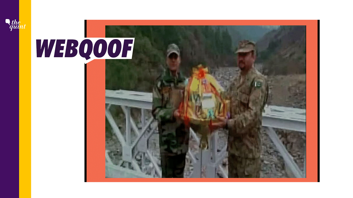 A video of Indian and Pakistani armies exchanging sweets on a bridge over a river is viral.