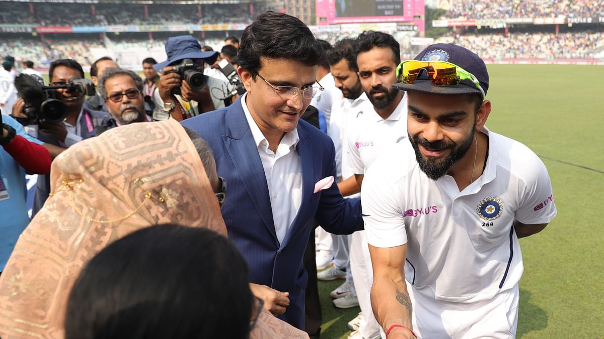 BCCI President Sourav Ganguly introduces Virat Kohli to the dignitaries ahead of the pink ball Test in Kolkata.