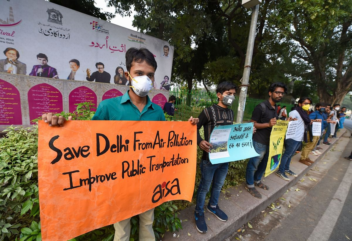 All India Students' Association (AISA) activists form a human chain demanding immediate steps to control air pollution at CP's Central Park, in New Delhi.