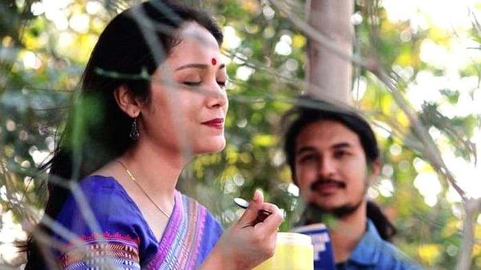 Lima Das and Arghadeep Baruah in a still from <i>Aamis</i>.