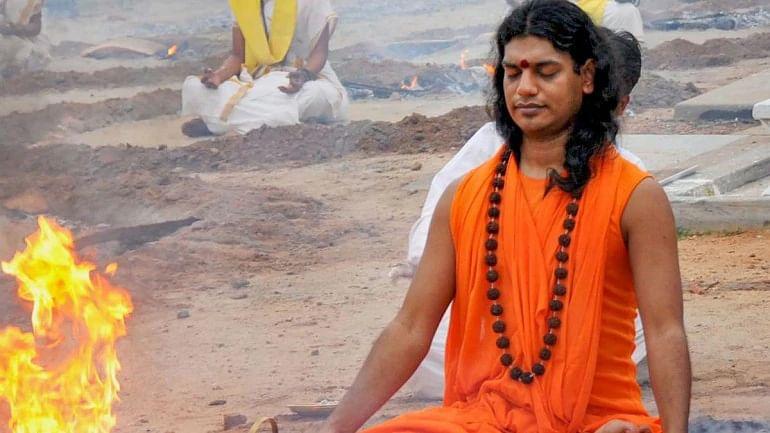 A photo of Nithyananda performing puja at his ashram in Karnataka.