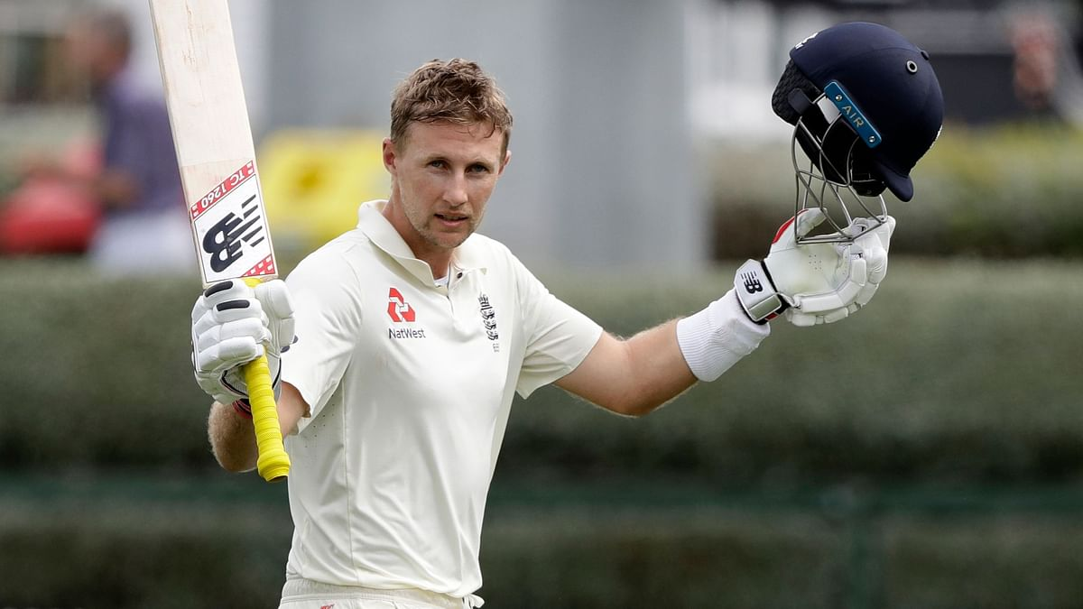 England's Captain Joe Root waves to the crowd as he leaves the field after he was dismissed for 226 runs during play on day four of the second cricket Test between England and New Zealand at Seddon Park in Hamilton on Monday, 2 December.