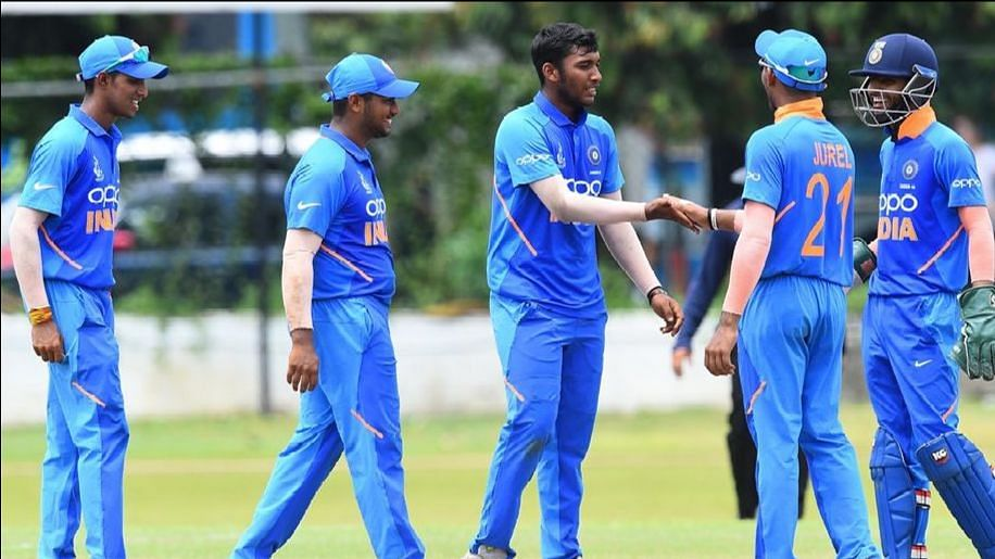 Atharva Ankolekar (centre) celebrating a wicket with his teammates.