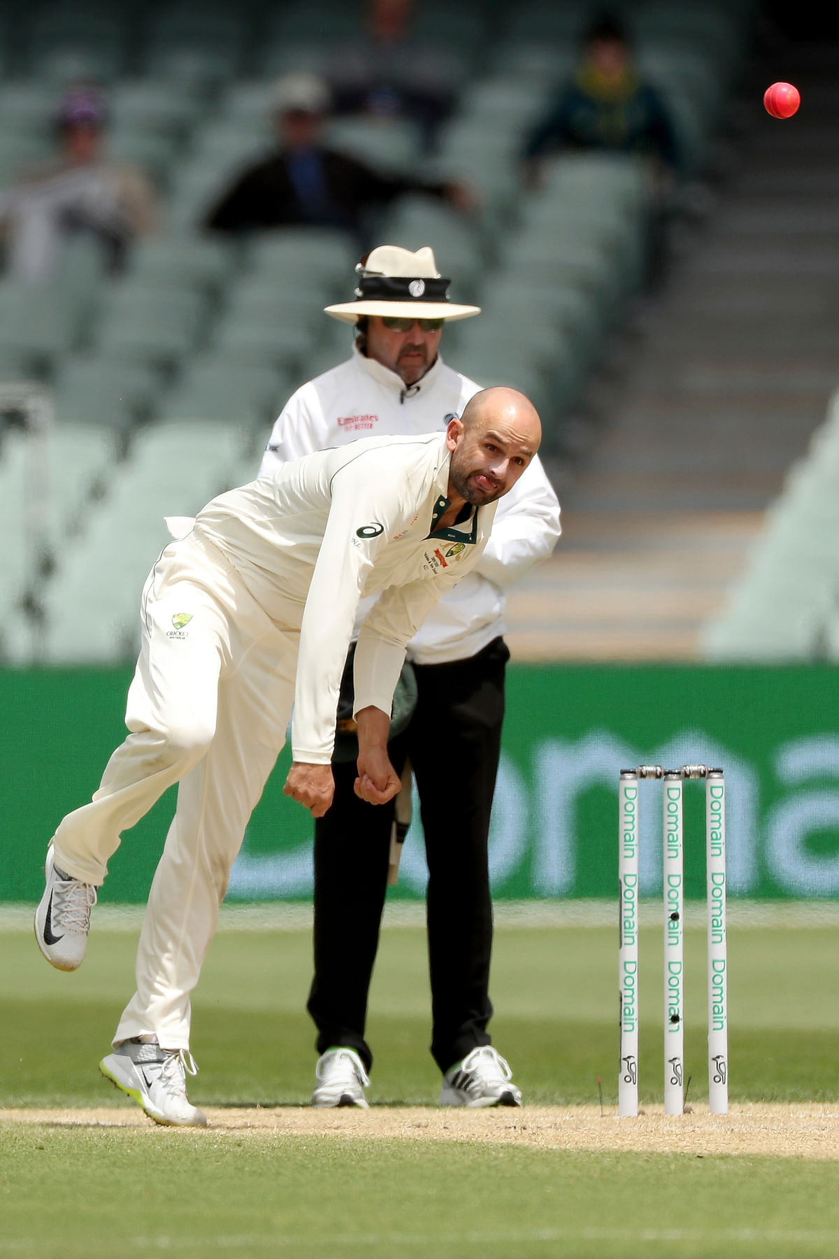 Australia's Nathan Lyon bowls during their cricket Test match against Pakistan in Adelaide.