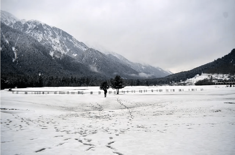 Foot-marks on a white expanse of snow in Kashmir.