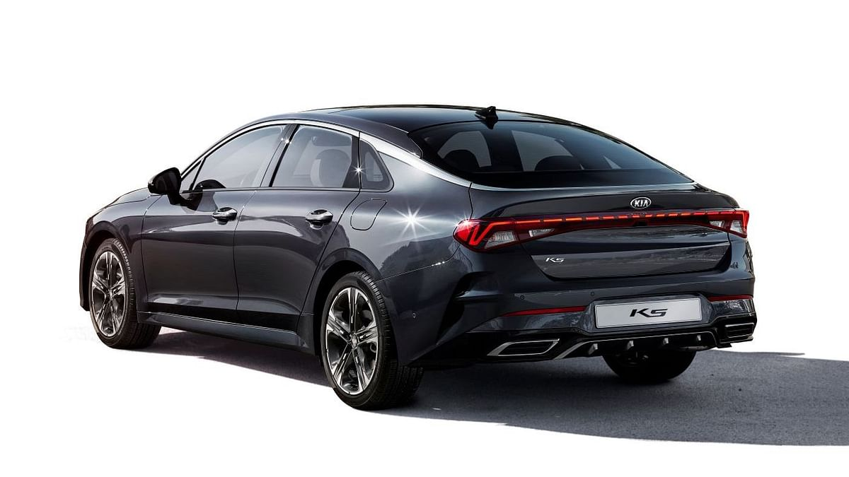 The Kia K5 sports a fast-back design and full-length tail-lamp.