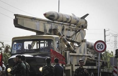 TEHRAN, April 18, 2015 (Xinhua) -- An Iranian military vehicle carrying a missile during the Army Day parade in Tehran, Iran, on April 18, 2015. Different units of Iranian army staged parades in a ceremony to show the latest Iranian military achievements. (Xinhua/Ahmad Halabisaz/IANS)