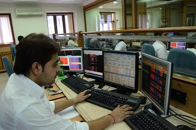 A stock broker looks at the Bombay Stock Exchange trading terminal as the BSE sensex is down by 254 points in Mumbai on August 19, 2013. (Photo::: Sandeep Mahankal/IANS)