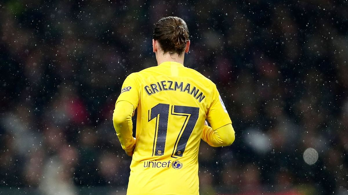 FC Barcelona's Antoine Griezmann in action during a Spanish La Liga soccer match between Atletico Madrid and FC Barcelona.