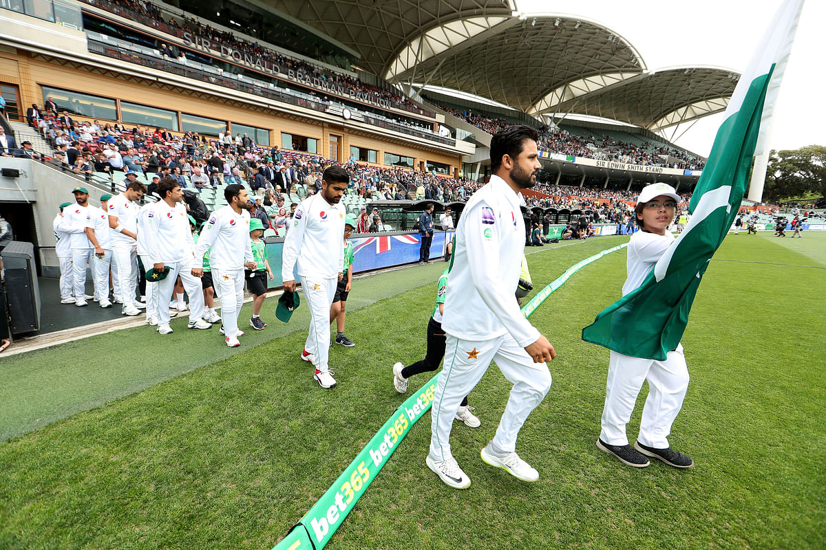 Pakistan's Azhar Ali leads his team out before their cricket test match against Australia in Adelaide,