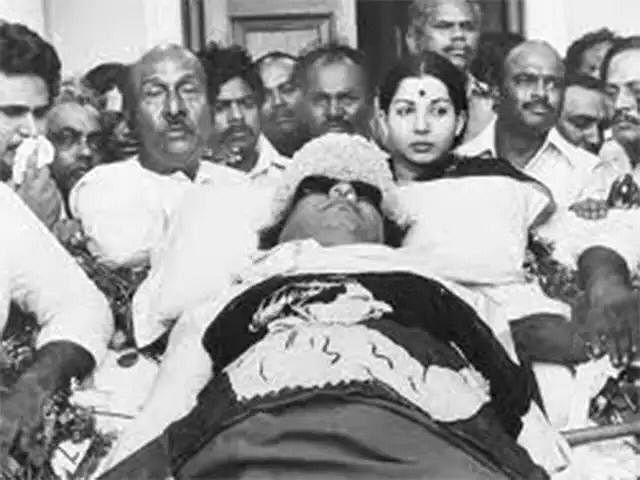 Jayalalithaa standing by MGR's body when he died in 1987.