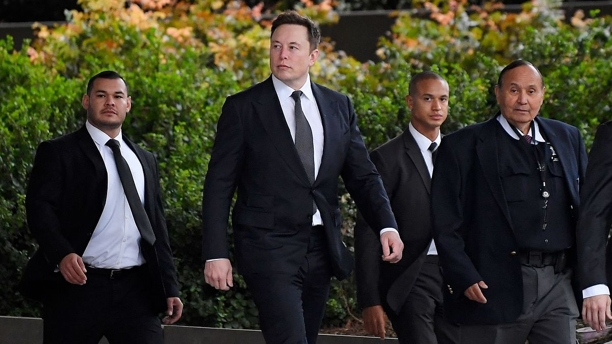 Tesla CEO Elon Musk, second from left, arrives at US District Court.