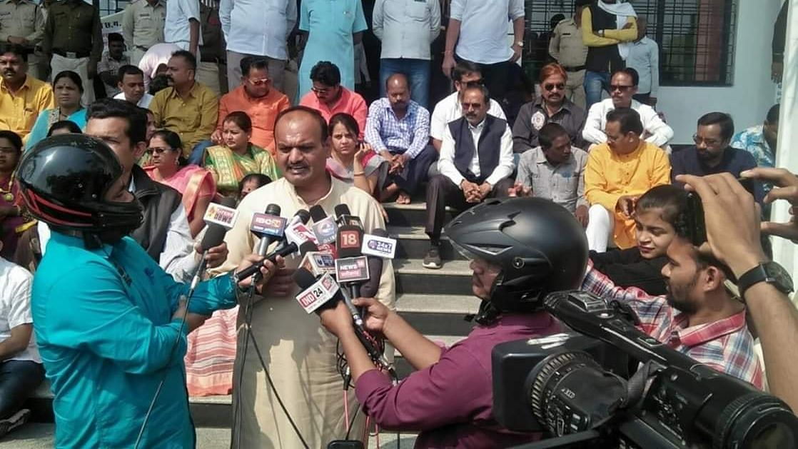 Indian journalists wear helmets to interview BJP leader in Raipur.