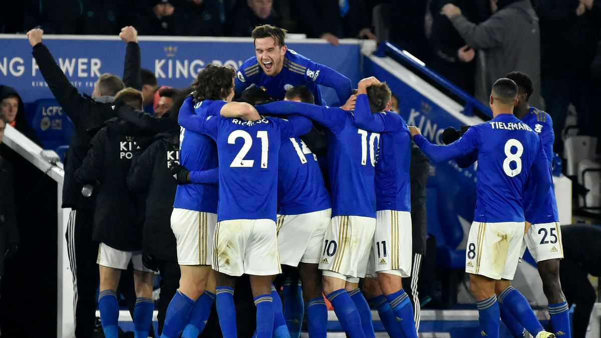 Leicester's Kelechi Iheanacho celebrates with teammates after scoring his side's second goal during the English Premier League match between Leicester City and Everton at the King Power Stadium in Leicester, England.
