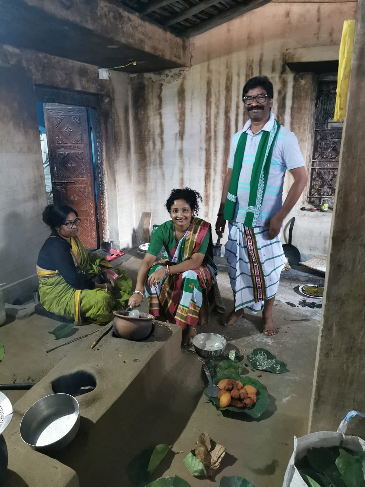 "Soren's campaign material showcased his ""grounded"" image. Here he can be seen with his wife and sister in a traditional kitchen."