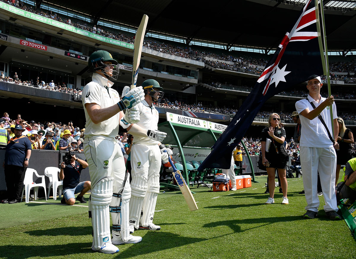 Australia's Steven Smith, left and Travis Head, right prepare to enter the field during play in their cricket test match against New Zealand in Melbourne, Australia, Friday, Dec. 27, 2019.