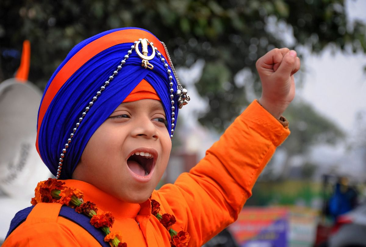 A young Sikh devotee during Nagar Kirtan procession dedicated to the martyrdom day of four Sahibzadas (sons) of the 10th Sikh Guru Govind Singh in Amritsar on Monday 23 December.
