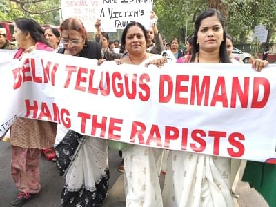 Members of the local Telugu community participate in a pre-scheduled protest march demanding death for the accused in the rape and murder of a young veterinarian in Hyderabad; at the Andhra Bhavan in New Delhi last week. But the apparent execution in an 'encounter' in the early hours of Friday, has not dampened their resolve to continue the fight against rape.