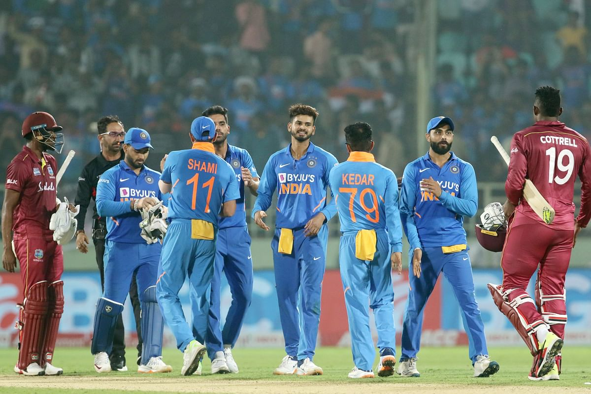 Indian and West Indies players shake hands after the 2nd ODI between India and the West Indies held at the ACA-VDCA Stadium, Visakhapatnam on the 18th December 2019.