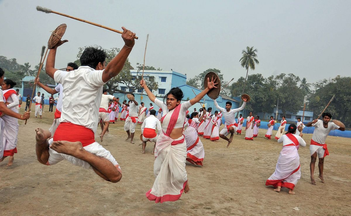 Partcipants from West Bengal and Bangladesh practise martial arts during the 60th All Bengal Bratachari Training Camp in Kolkata on Thursday,26 December.