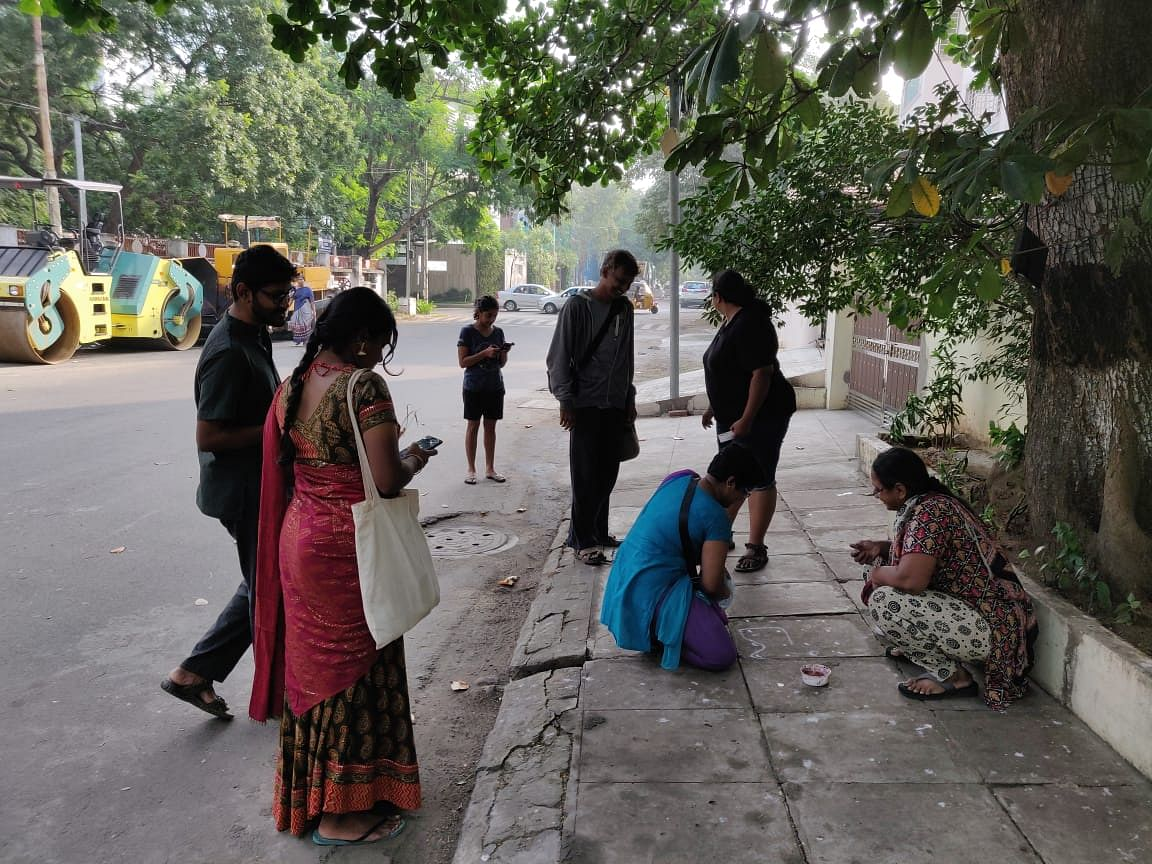 Protesters drawing kolams <em>(rangoli) </em>outside people's houses with anti-CAA slogans, shot on Sunday, 29 December.
