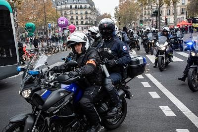 PARIS, Dec. 5, 2019 (Xinhua) -- Police patrol the city during a strike in Paris, France, Dec. 5, 2019. Train and metro stations are deserted, schools closed and many aircrafts grounded across French cities on Thursday as the country