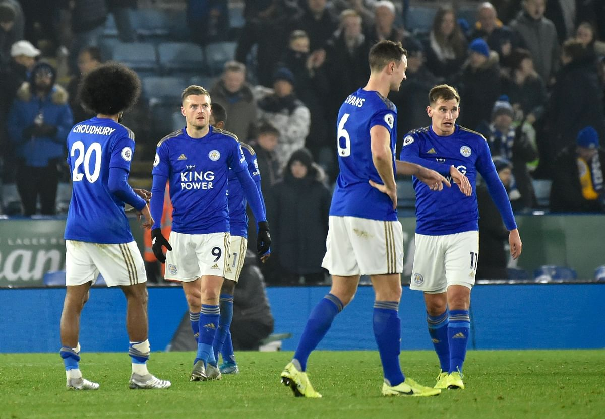 Leicester players walk on the pitch in dejection at the end of the English Premier League soccer match between Leicester City and Liverpool at the King Power Stadium in Leicester, England, Thursday, Dec. 26, 2019.