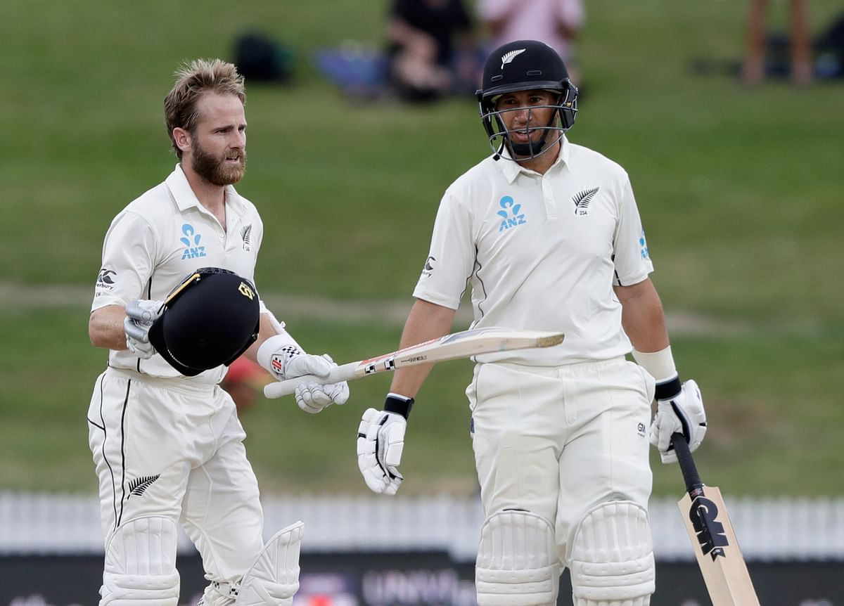 New Zealand's Kane Williamson, left, reacts after scoring a century as teammate Ross Taylor looks on during play on the final day of the second cricket Test.