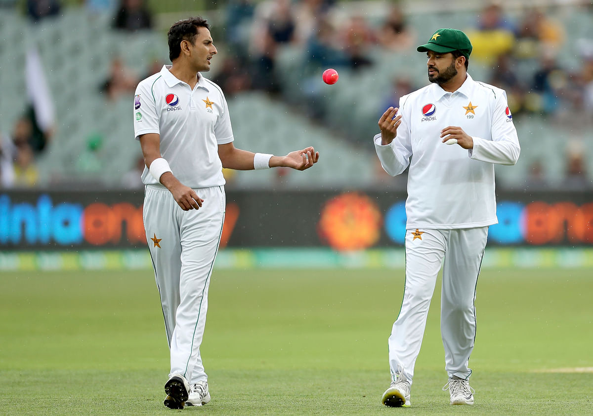 Pakistan's Mohammad Abbas, left, talks to Azhar Ali during their cricket test match against Australia in Adelaide.