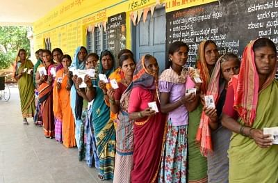 Raichur: Women voters wait in a queue to cast their votes for the third phase of 2019 Lok Sabha elections, at a polling station in Karnataka