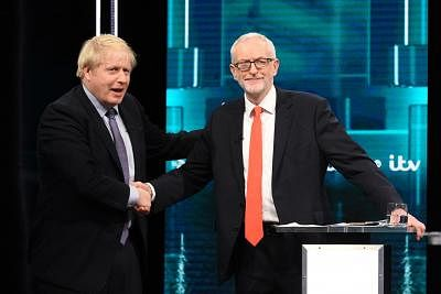 SALFORD, Nov. 20, 2019 (Xinhua) -- In this handout image provided by ITV, British Prime Minister Boris Johnson (L) and British Labour Party leader Jeremy Corbyn shake hands during their election head-to-head debate live on ITV in Salford, Britain, Nov. 19, 2019. Boris Johnson and Jeremy Corbyn faced a national audience on Tuesday night in the first ever televised head-to-head clash between the country