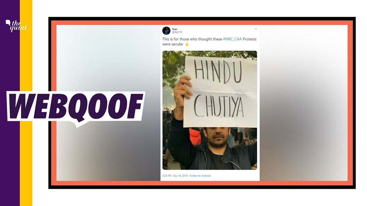 A picture is being circulated on the internet that shows one of the protesters holding a placard abusing Hindu community.