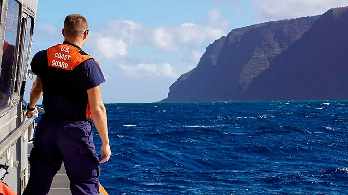In this photo released by the U.S. Coast Guard, Coast Guard Cutter William Hart moves toward the Na Pali Coast on the Hawaiian island of Kauai.