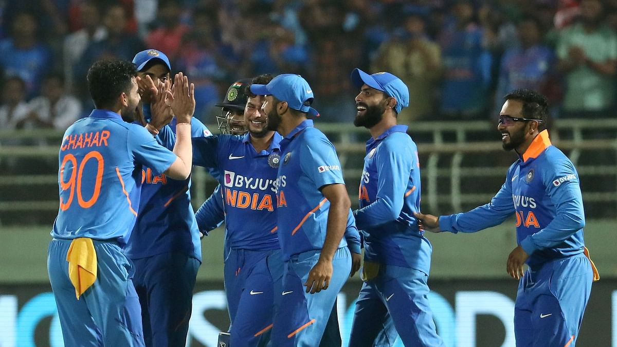 India players celebrate the wicket of Alzarri Joseph of West Indies and also the hat-trick of Kuldeep Yadav, during the 2nd ODI between India and the West Indies.