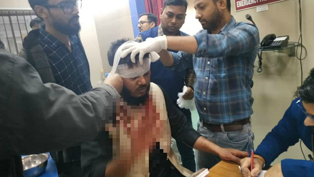 At least two dozen protesters and police personnel were injured in clashes that broke out at Delhi's Jamia Millia Islamia University.