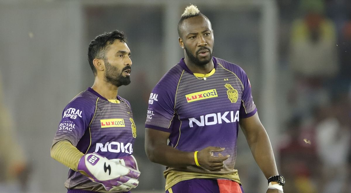 Dinesh Karthik with KKR's star player Andre Russell. While the players had their differences in the 2019 season, both have been retained by the franchise.