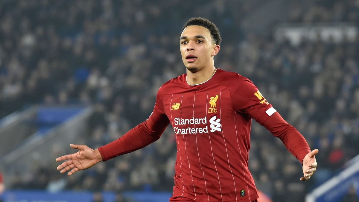 Liverpool's Trent Alexander-Arnold celebrates after scoring his side's fourth goal during the English Premier League soccer match between Leicester City and Liverpool at the King Power Stadium in Leicester, England, Thursday, Dec. 26, 2019.