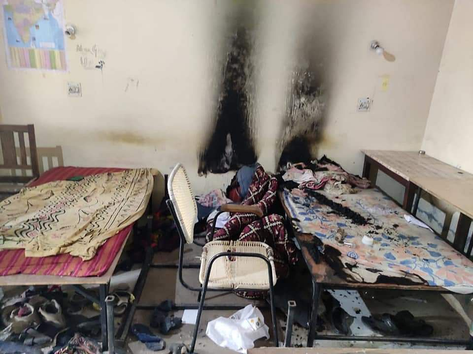 An entire room was burnt by tear-gas shells.