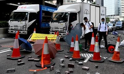 HONG KONG, Nov. 14, 2019 (Xinhua) -- Rioters block roads and disrupt traffic in Central area in Hong Kong, south China, Nov. 13, 2019. It has been more than five months since the proposed ordinance amendments concerning fugitives