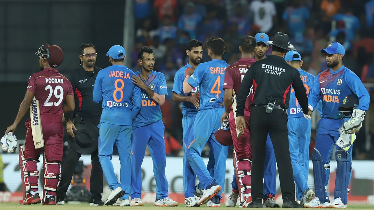 Indian players congratulate the West Indies batters after the second T20I match between India and the West Indies held at the Greenfield Stadium, Thiruvananthapuram.