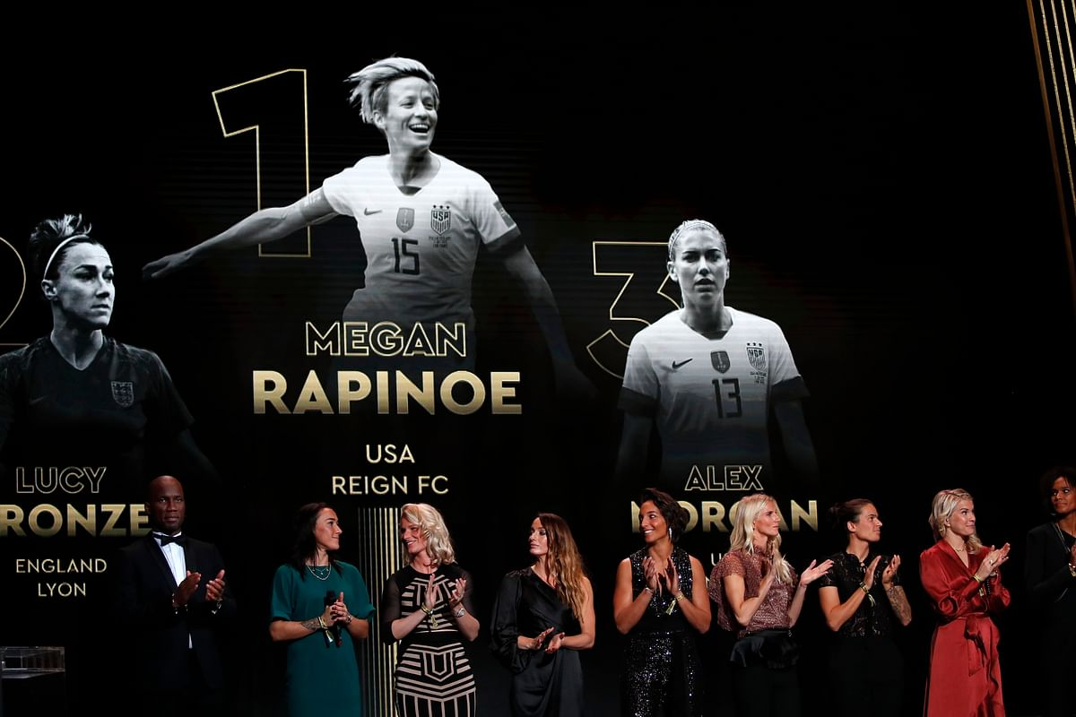 US Megan Rapinoe is seen on the screen after she awarded as the best female soccer player during the Golden Ball award ceremony at the Grand Palais in Paris, Monday, Dec. 2, 2019.