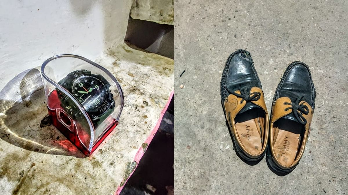 On the left is Suleiman's watch bought by his aunt and never worn by him, and on the right is Anas' shoes. Their belongings remain untouched now.