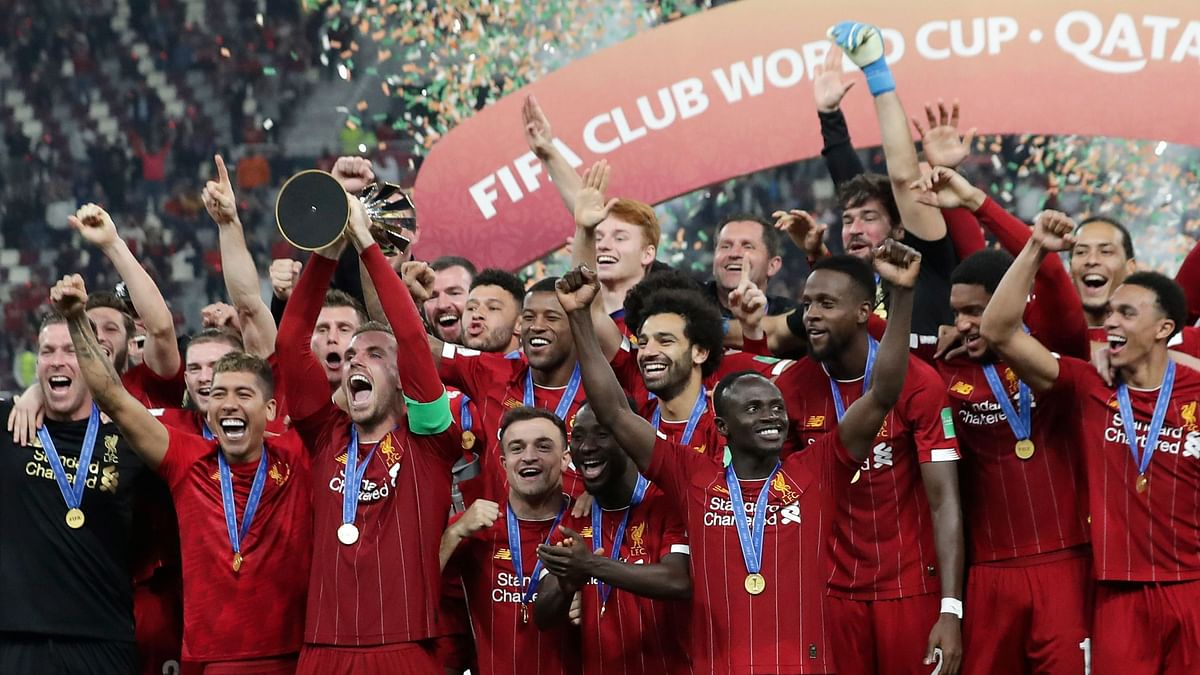 Players of Liverpool celebrate after winning the Club World Cup final soccer match between Liverpool and Flamengo at Khalifa International Stadium in Doha, Qatar, Saturday, Dec. 21, 2019.