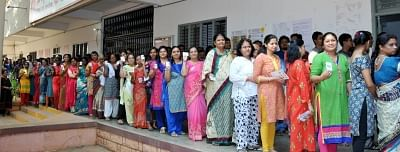 Tumakuru: People stand in multiple queues to cast their votes for the second phase of 2019 Lok Sabha elections, at a polling station in Karnataka