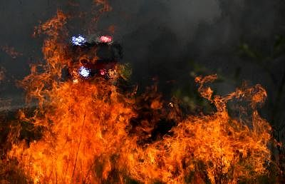 NEW SOUTH WALES, Nov. 11, 2019 (Xinhua) -- Firefighters battle the flames during bushfires near Taree, New South Wales, Australia, Nov. 11, 2019.A devastating start to the Australian bushfire season has prompted a state of emergency in the eastern state of New South Wales (NSW), with the country