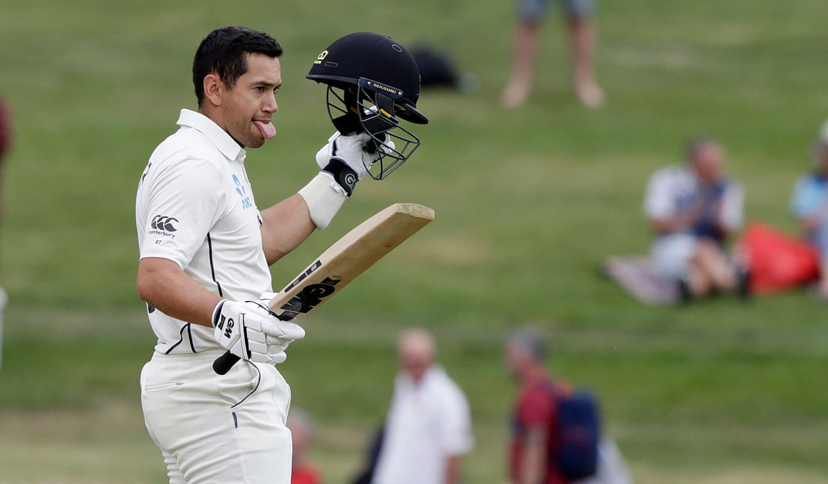 New Zealand's Ross Taylor celebrates after scoring a century during play on the final day of the second cricket Test.