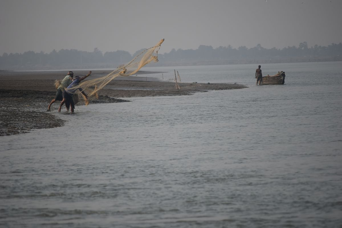 Villagers of Chaumukh engaged in fishing activity.