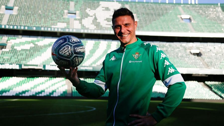 Joaquin Sanchez poses with the match ball after scoring a hat-trick in Real Betis's 3-2 win over Athletic Bilbao.