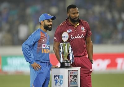 Kolkata: Indian skipper Virat Kohli and West Indies captain Kieron Pollard pose with the Trophy ahead of the first T20I match between India and the West Indies at the Rajiv Gandhi International Stadium in Hyderabad on Dec 6, 2019. (Photo: Surjeet Yadav/IANS)