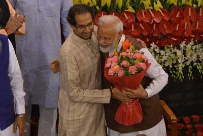 New Delhi: Shiv Sena president Uddhav Thackeray greets Prime Minister Narendra Modi during NDA Parliamentary Board meeting at the Central Hall of Parliament, in New Delhi on May 25, 2019. (Photo: IANS)